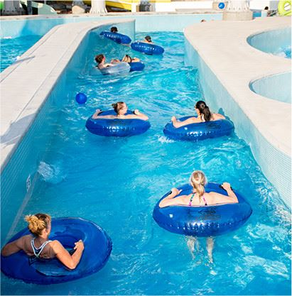 People floating down lazy river in tubes
